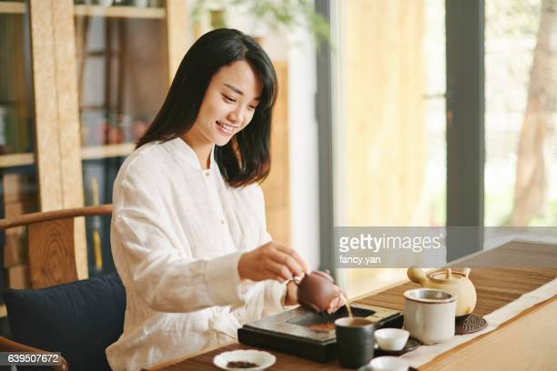 Young woman in the tea ceremony