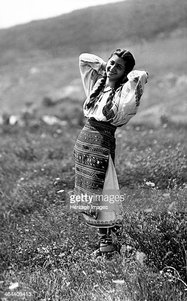 Young woman in traditional costume Bistrita Valley Moldavia northeast Romania c1920c1945 Depicting customs and traditional labour in the rural...