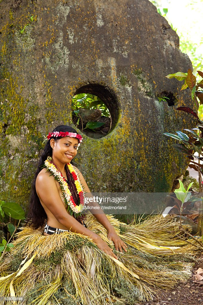 Young woman in traditional dress at site of stone money in Yap, Micronesia. : Stock Photo