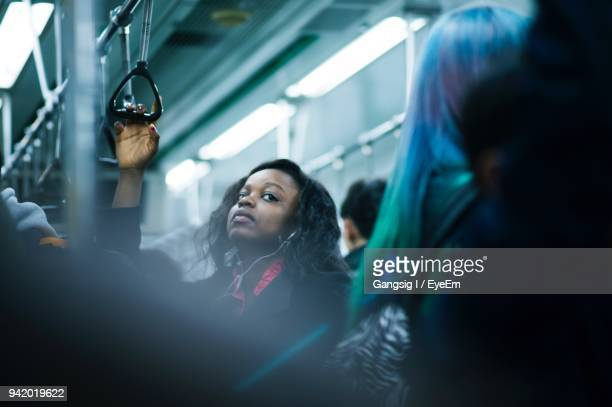 young woman in train - subway train stock pictures, royalty-free photos & images