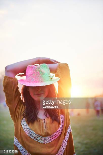 young woman in trilby covered in coloured chalk powder at holi festival, overhead view - festival goer stock pictures, royalty-free photos & images