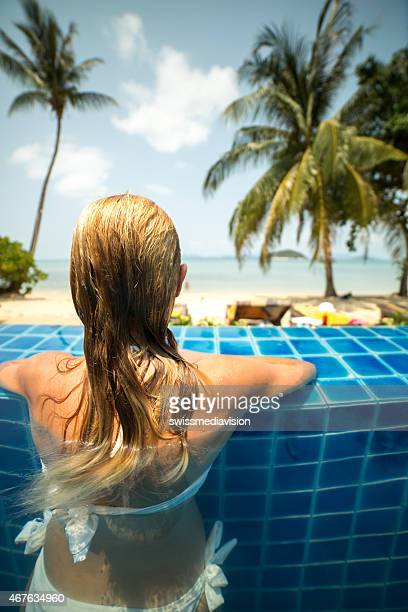 Young woman in tropical tourist resort