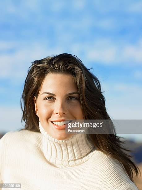 Young woman in turtleneck sweater, portrait