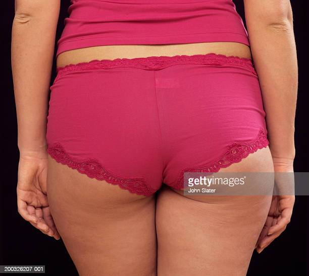 young woman in underwear, close-up, rear view - femme pulpeuse photos et images de collection