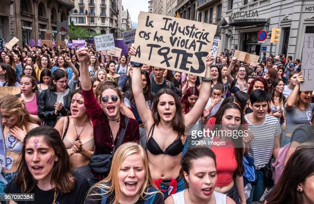 A young woman in underwear is seen showing a sign with the label injustice violates us all Under the slogan it's not abuse it's rape more than 5000...
