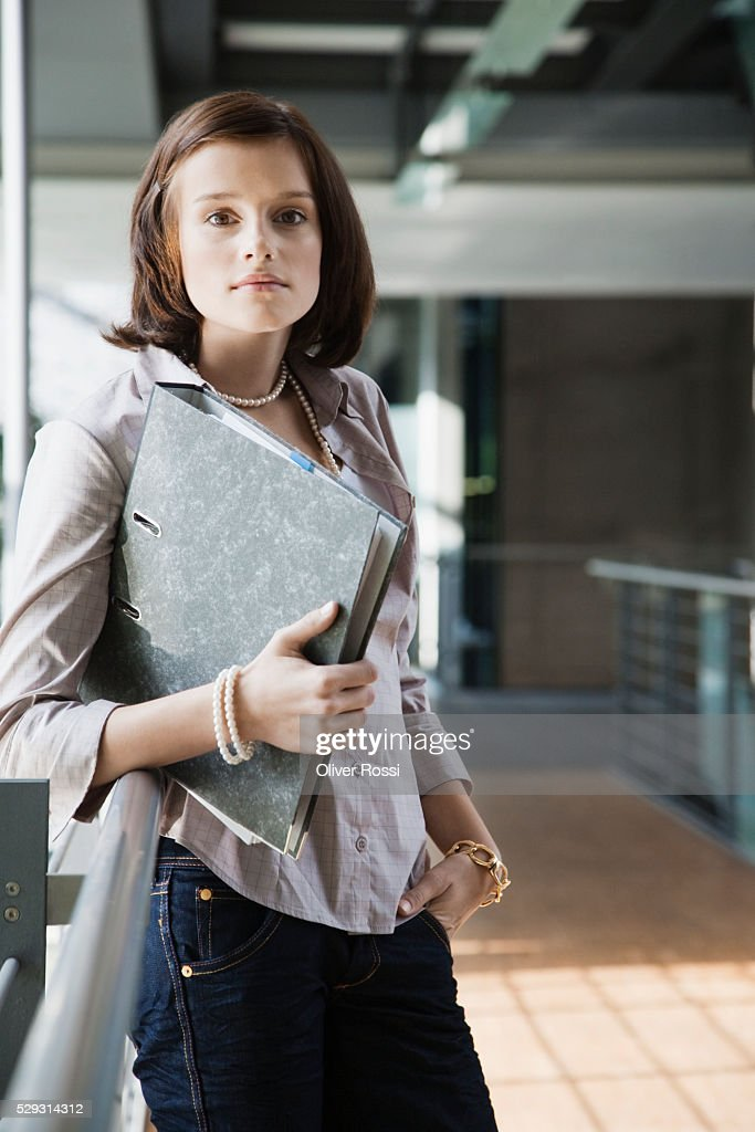 Young woman in university : Stock Photo