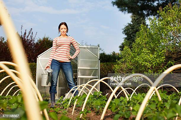 Young woman in vegetable garden
