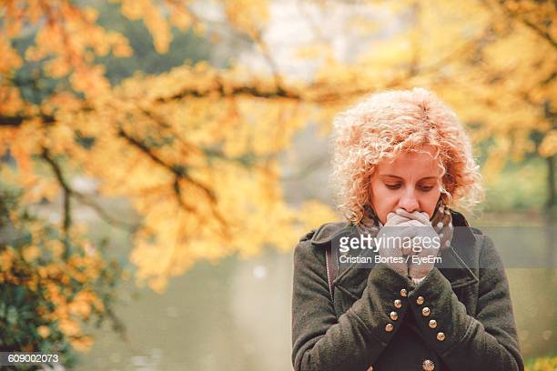 young woman in warm clothing during winter - bortes cristian stock-fotos und bilder
