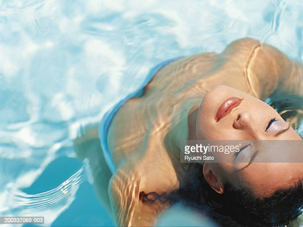 Young woman in water, close-up, elevated view