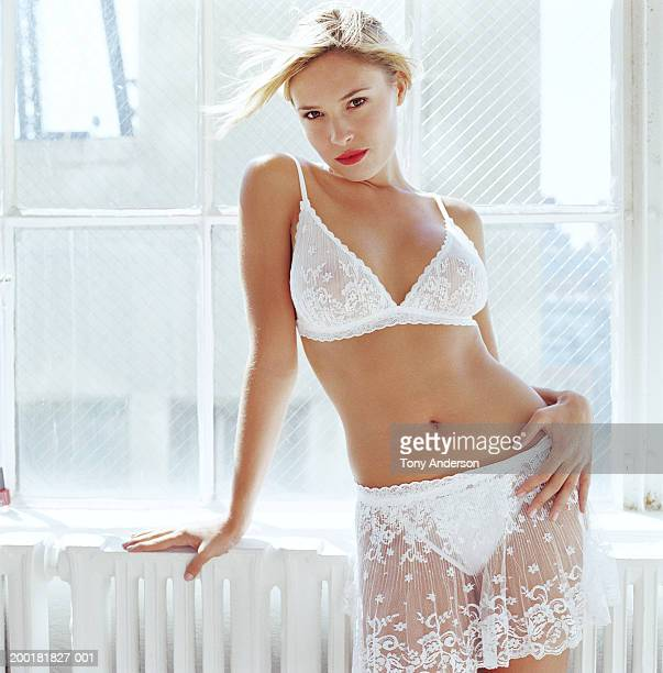 young woman in white negligee, portrait - women in slips stock photos and pictures