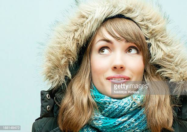 young woman in winter clothes - parka coat stock photos and pictures