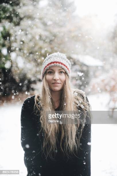 Young Woman in Wool Hat in the Snow
