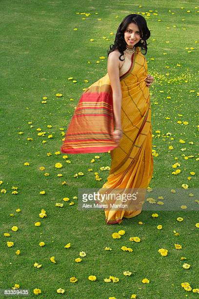 young woman in yellow sari