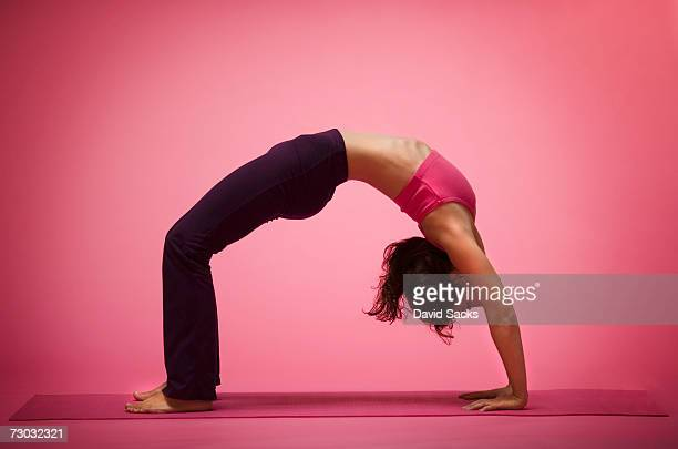 Young woman in yoga back bend, side view
