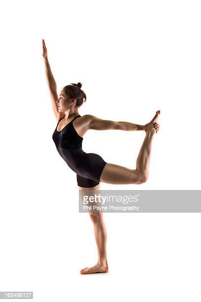 Young Woman in Yoga Bow Pose