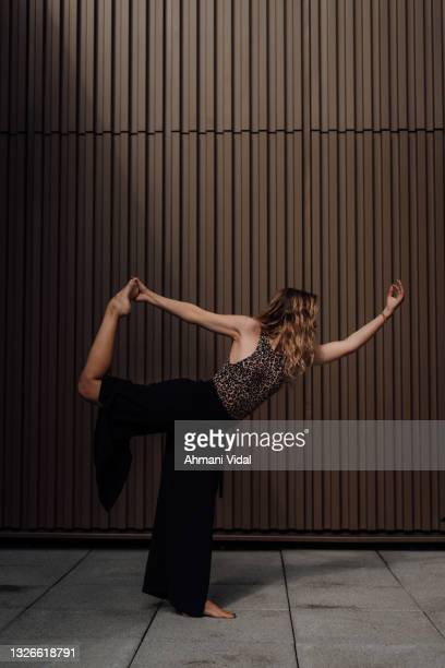 young woman in yoga pose - one mid adult woman only stock pictures, royalty-free photos & images