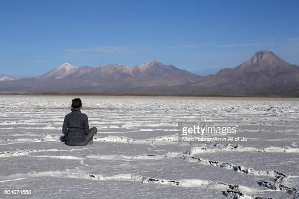 Young woman in Yoga position meditating on November; 2016 in Salar de Uyuni; Bolivia.