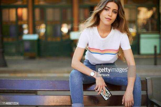 young woman influencer posing for social media. - influencer stock pictures, royalty-free photos & images