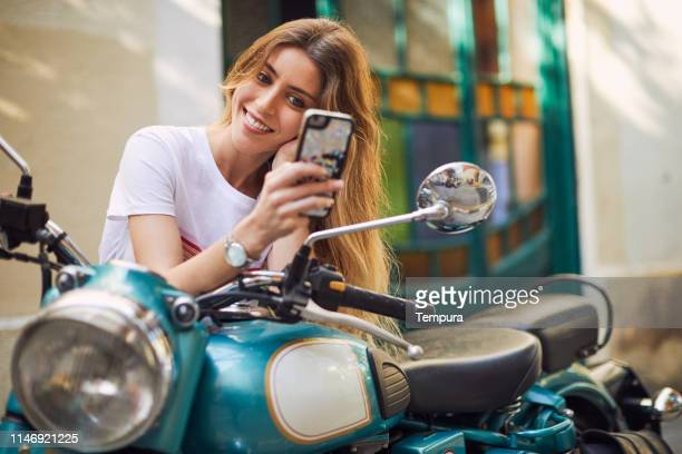 young woman influencer posing for social media. - social media marketing stock pictures, royalty-free photos & images