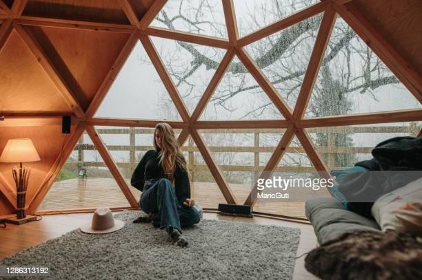 young woman inside a wooden dome - domo imagens e fotografias de stock