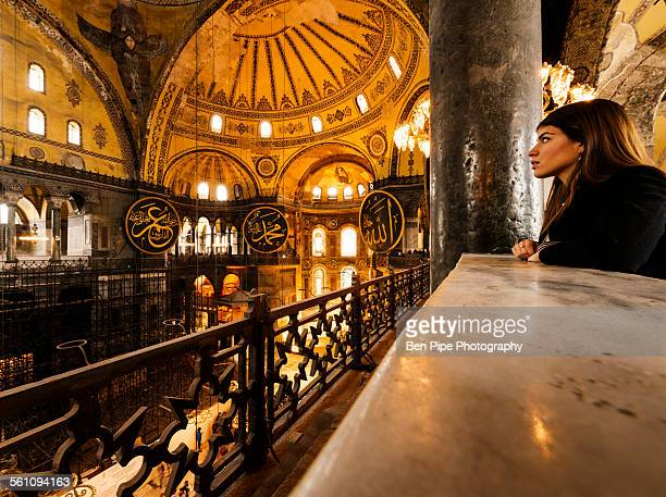 Young woman inside Hagia Sophia mosque, Istanbul, Turkey