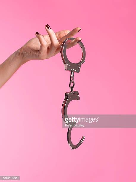 young woman into bondage - handcuffs stock pictures, royalty-free photos & images
