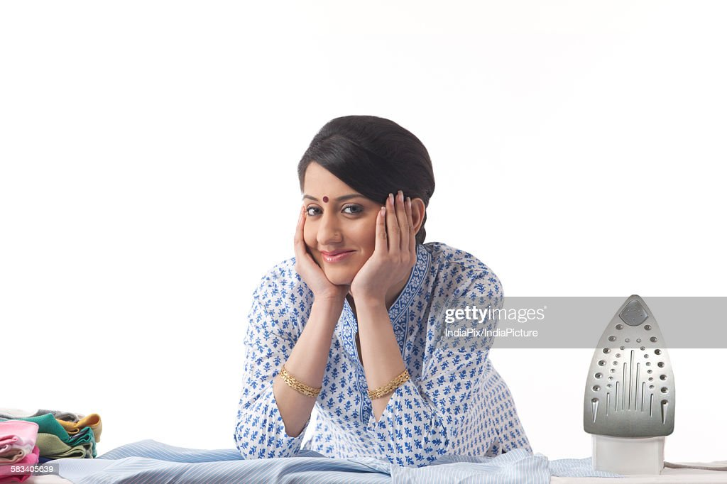 Young woman ironing : Stock Photo