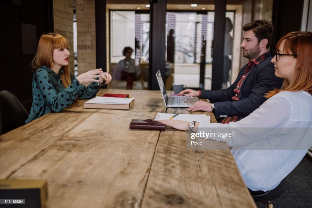Young woman Is a Bit Nervous On Her Job Interview : Stock Photo