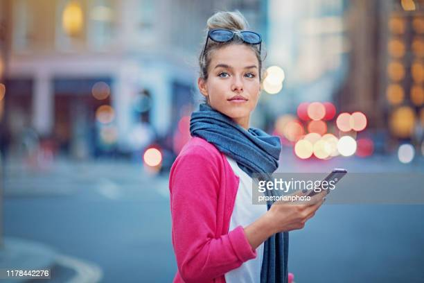 young woman is crossing the street - pedestrian stock pictures, royalty-free photos & images