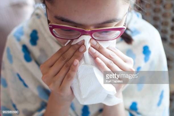 a young woman is having a flu - mucus stock pictures, royalty-free photos & images