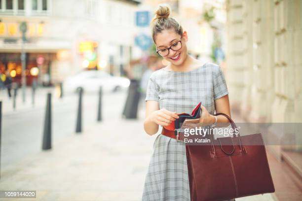 young woman is having fun in the city - autumn mood - clutch bag stock pictures, royalty-free photos & images