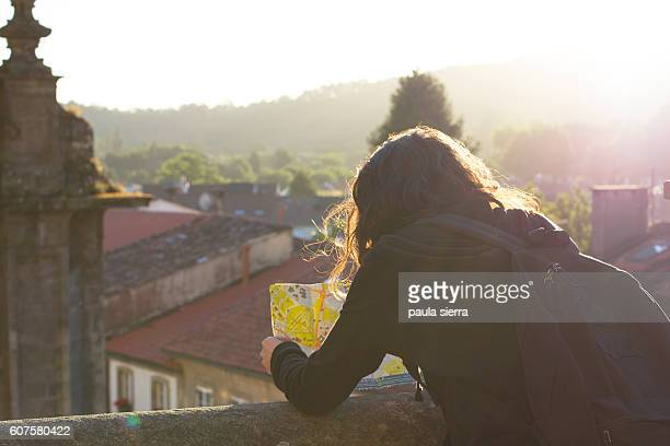 Young woman is looking at map