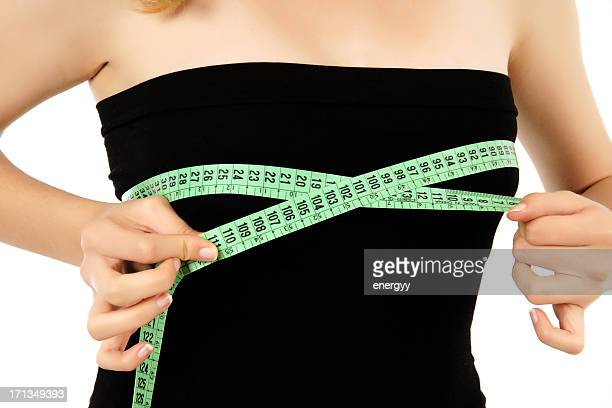 young woman is measuring her breast (xxxl) - big cleavage stock photos and pictures
