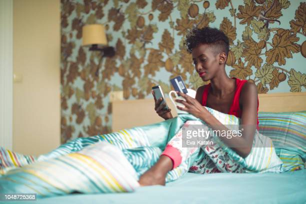 Young woman is on the phone in her bedroom