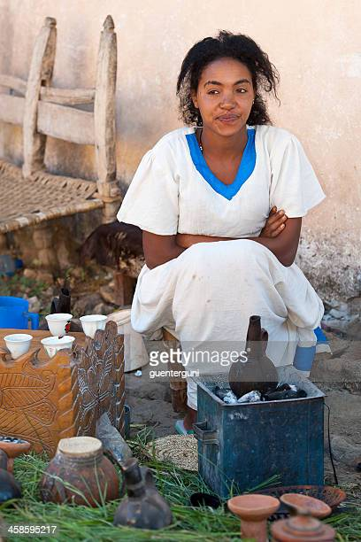 Young woman is preparing a traditional coffee ceremony, Ethiopia