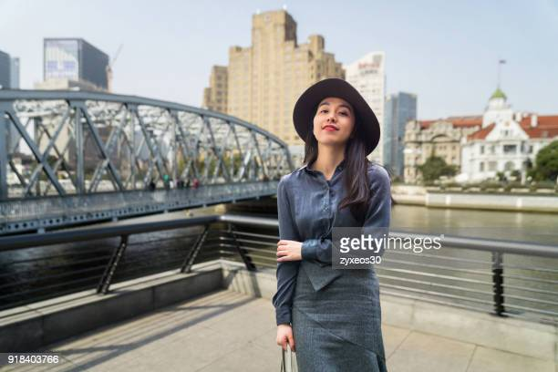a young woman is professional manager worker in the shanghai bund,china - east asia. - china east asia stock pictures, royalty-free photos & images