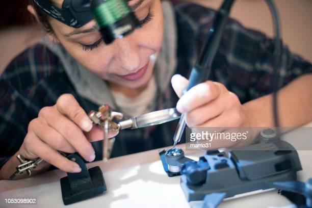 young woman is repairing a drone - dismantling stock pictures, royalty-free photos & images