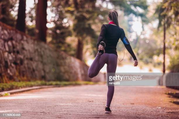 young woman is running - womens track stock photos and pictures