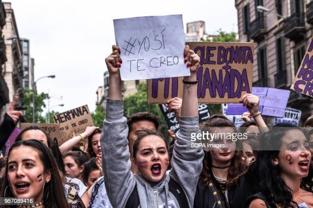 A young woman is seen showing a sign with the text I do believe you Under the slogan it's not abuse it's rape more than 5000 high school and...