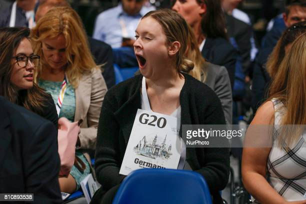 A young woman is seen yawning during the wait for the arrival of German chancellor Angela Merkel for the closing press conference of the G20 summit...