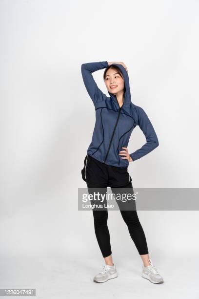 a young woman is shooting in the studio - studio shot stock-fotos und bilder