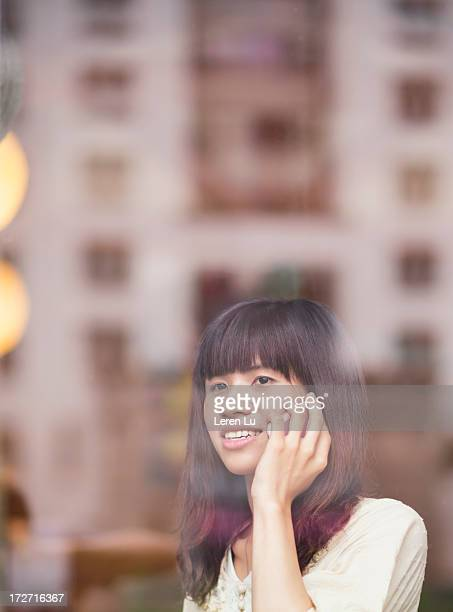 young woman is talking by smart phone - leren stock pictures, royalty-free photos & images