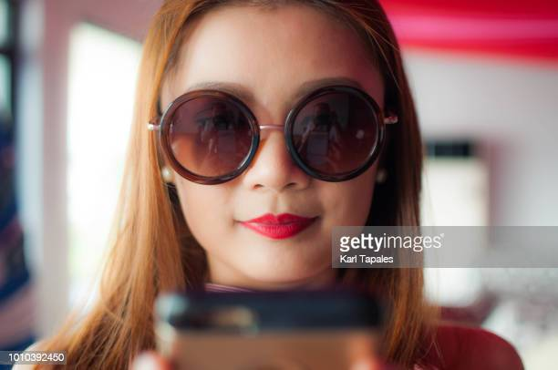 A young woman is using a mobile phone