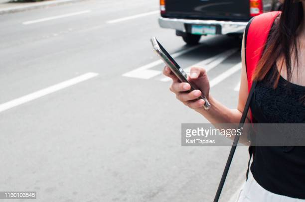 A young woman is using a smartphone in the city