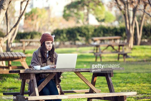 young woman is using laptop