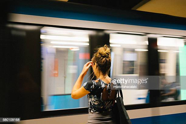Young woman is waiting for the metro in Montreal