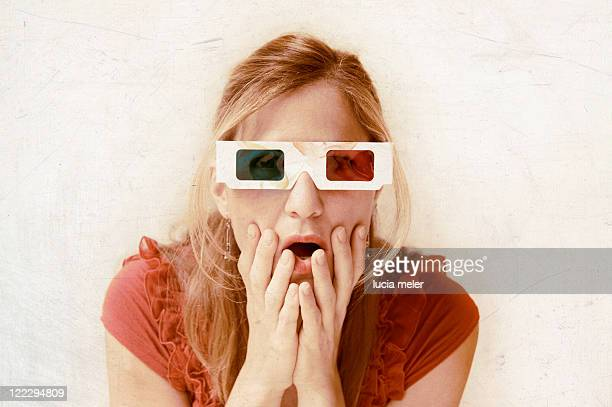 Young woman is wearing 3D glasses