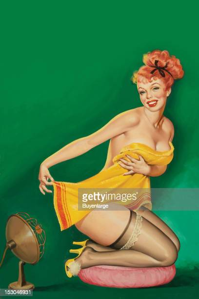 Young woman is wrapped only in a bating towel but wearing yellow high heels and silk stockings with lace garters a fan blows on her 1952 By Peter...