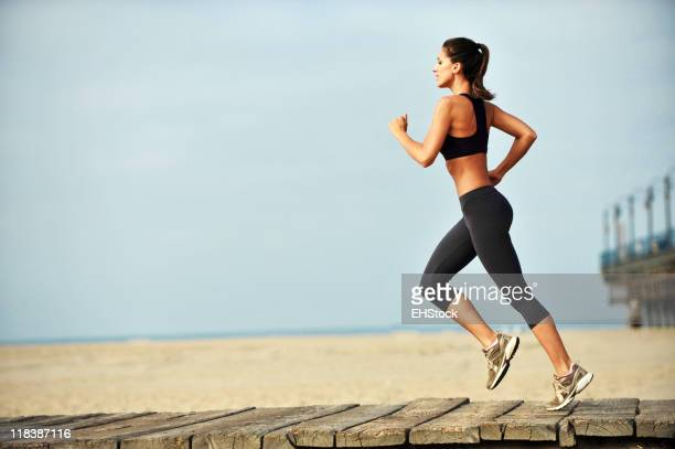 Young Woman Jogging on Boardwalk Santa Monica Beach