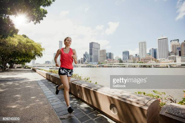 Young Woman Jogging on Brisbane Southbank